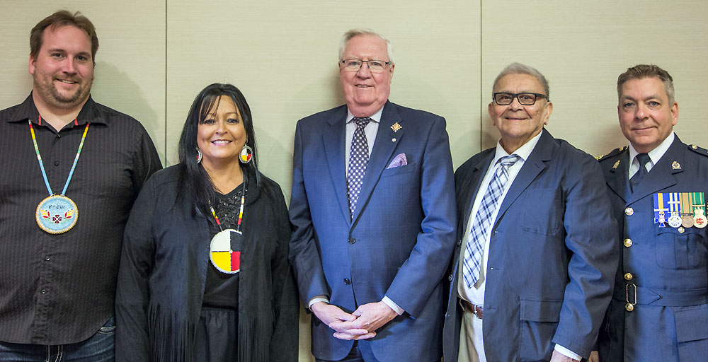 Photo from left to right- Chris McKee; Converging Pathways – Kallie Wood; Converging Pathways; His Honour the Honourable W. Thomas Molloy; Lieutenant Governor of Saskatchewan -  Chief Dr. Robert Joseph; Reconciliation Canada – Chief Rick Bourassa; Moose Jaw City Police.